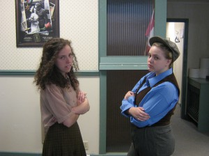 Meaghan Brackenbury and Bobbie Cordick (arguing the merits of women's suffrage) at the Perth Courier offices. The tour begins June 25.