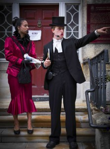 Historical figures May Bell-Marks (played by Jasmine Bowen) and Rev. William Bell (played by Sean Jacklin) express their shock at the 21st century Gore Street in Perth